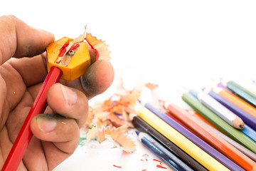colorful pencils and pencil Sharpener on white background