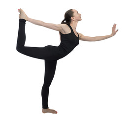 Young girl practicing yoga, lord of the dance pose