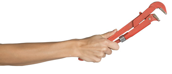 Female hand holding gas wrench