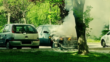 Car engulfed in flames with lot of smoke