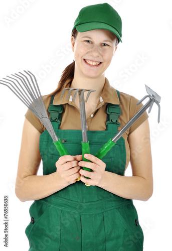 canvas print picture Gärtner in grüner Latzhose mit Garten-Werkzeugen
