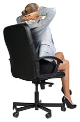 Businesswoman sitting back in chair with hands clasped behind