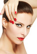 Beautiful make up with red nails and lips