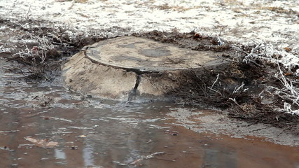 Manhole's accident on street , water flows