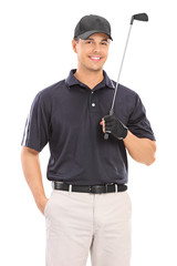 Young professional golfer posing