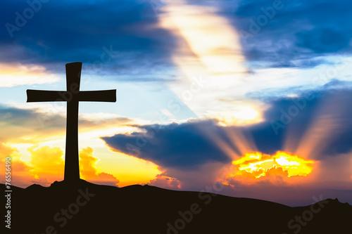 Foto op Plexiglas Landschappen cross silhouette on mountain with ray sunset sky.