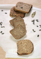 Different kinds of bred with pumpkin seeds and bay leaf