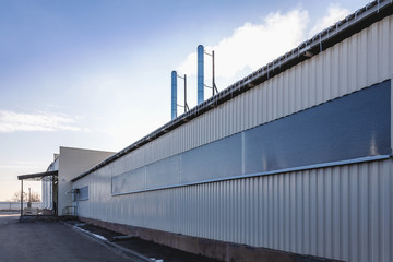 Wall of industrial building with pipes