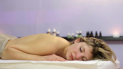 beautiful blonde girl relaxes during massage at the health spa