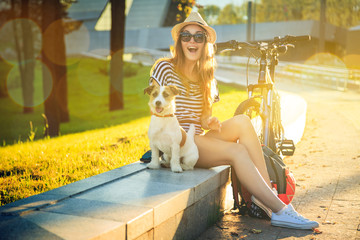Happy Hipster Girl with her Dog in the City