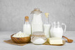 Dairy products on wooden table over vintage abstract background - 76561280