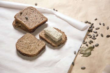 Different kinds of bred with tofu cheese and pumpkin seeds