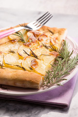 focaccia with sliced potatoes and rosemary, selective focus