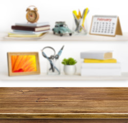 Wooden table on background of shelves with office objects