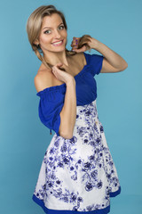 beautiful smiling girl in a blue dress