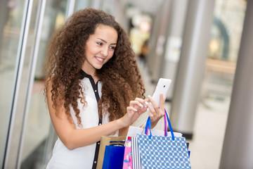 beautiful young woman goes shopping