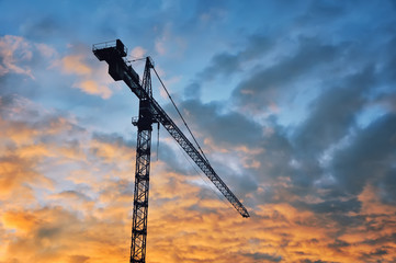Building tower crane with sunset sky