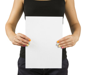 young girl with bright manicure keeps empty paper sheet
