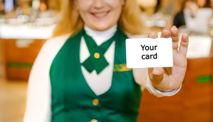 Shop assistant's hand is showing the card