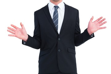 Well dressed businessman with hands up