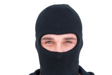 Portrait of man in balaclava looking at camera