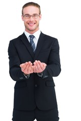 Smiling businessman holding out his hands