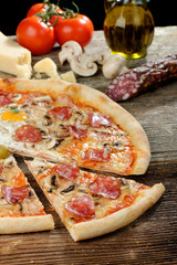 Delicious italian pizza with Salami and egg