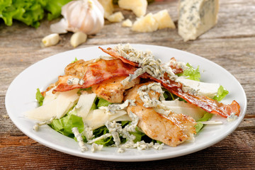 Bowl of Traditional Caesar Salad with Chicken and Bacon