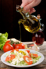 Fresh italian salad with mozzarella, tomato and olive oil