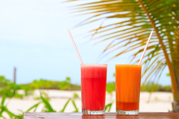 Fruit juices on tropical beach