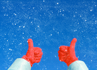 thumbs up on winter snow