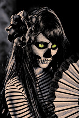 Young woman in day of the dead mask skull face art.