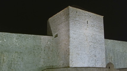 Dubrovnik old town walls detail by night.