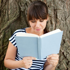 Middle-aged woman reading book