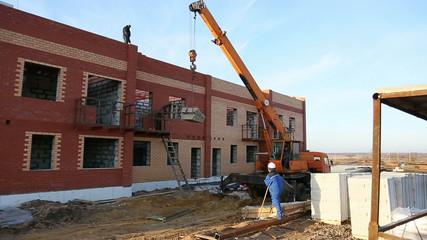 Crane at a construction site, construction townhouse