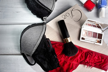 Makeup accessories and lingerie on date calendar