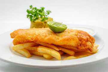 Fried fish with mashed peas isolated
