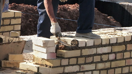 Construction townhouse, work bricklayer, masons
