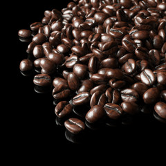 Roasted coffee beans on black background for advertising