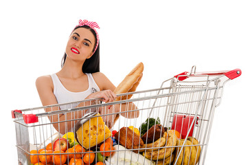beautiful woman with shopping trolley supermarket