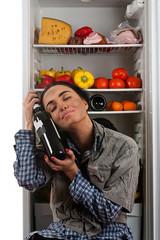 dirty drunkard hugging a bottle of wine