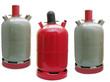 Leinwanddruck Bild - Propangasflaschen (graue Eigentumflasche, rote Mietflasche)