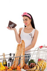woman with a supermarket trolley and cheese in the hand