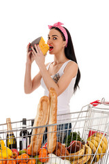 beautiful woman with a trolley supermarket eating cheese