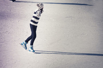 Teenager girl at the ice rink