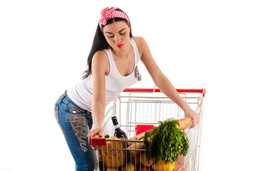 beautiful woman pushes a cart supermarket