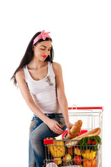 beautiful woman sitting on a shopping trolley