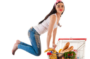 beautiful woman with a supermarket trolley in a jump