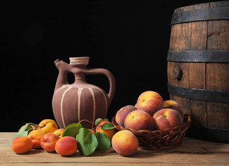 Apricots, peaches and ceramic carafe