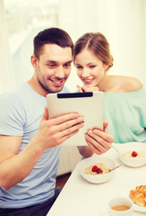 smiling couple with taking picture with tablet pc